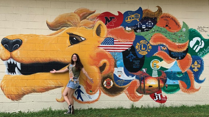 Girl Scout Gabrielle Edwards painted a mural as her Gold Award project and to give back to the local Lions banquet hall where she and her family spent so much of their time.