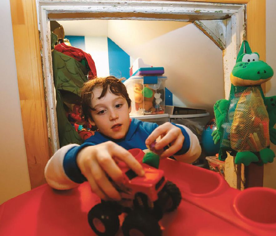 Peter McHugh plays in his room, renovated with the help of Lions. PHOTO BY THE CANADIAN PRESS IMAGES/PATRICK DOYLE