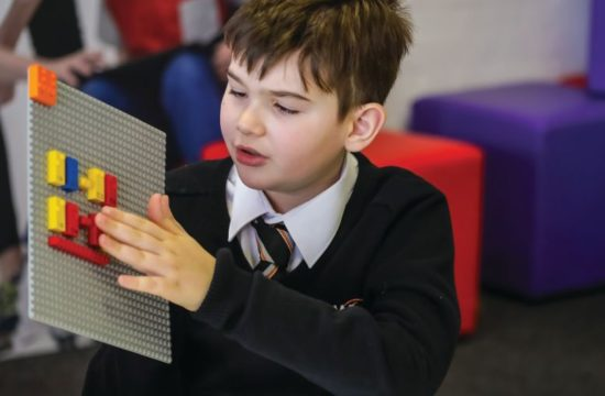 With printed letters, numbers, and symbols, the new LEGO Braille Bricks can be enjoyed by all. PHOTO COURTESY OF THE LEGO GROUP