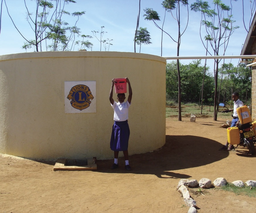 Mwita is proud that her school's water tank provides clean water to everyone in her village.