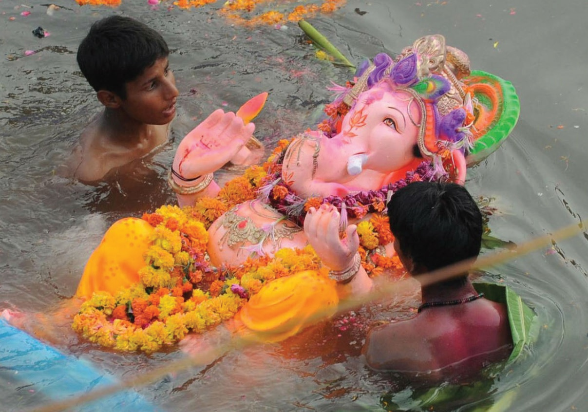 A traditional Ganesha idol is immersed into the sea.