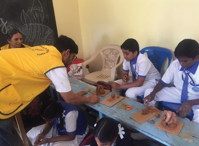 Leo Yashas teaches the schoolchildren how to make environmentally friendly clay Ganesha idols.