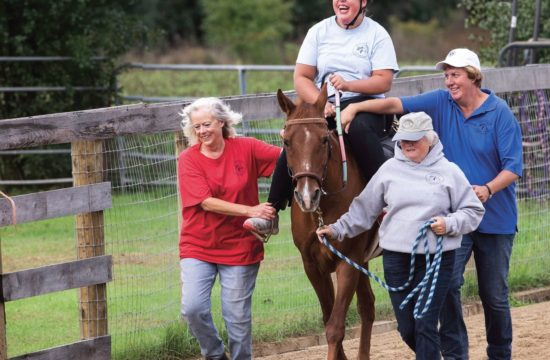 Hailey, 12, walks better after she rides, making the lessons not only fun, but great physical therapy. PHOTO BY LAUREN JUSTICE