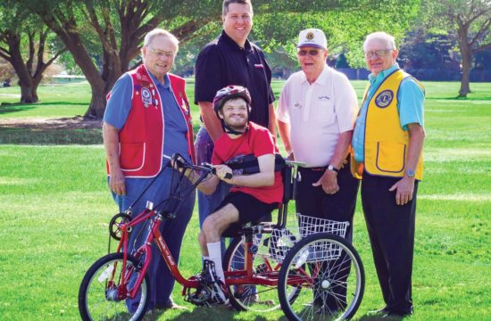 Cycle For Life recipient Jerrod Meyers poses with Dan Pope, President of the Redbud Lions Club, which is the National Sponsor of the Cycle for Life Project, Bryan Steward, Manager of W. W. Grainger, Lubbock Store which donated funds for several cycles, Marshall Cooper, Past International Director, and Joe Tarver, Cycle for Life coordinator. Photo by Kelsey Hart.