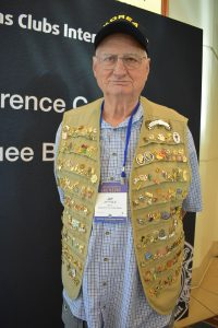 Lion in a vest with a lot of pins.