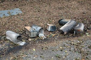 Scorched mailboxes lie on the gground, their posts burned from the Beachie Creek Fire.