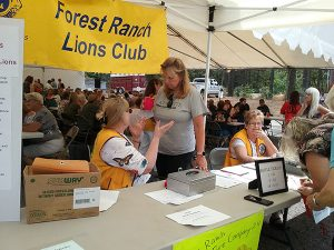 Lions work a relief booth
