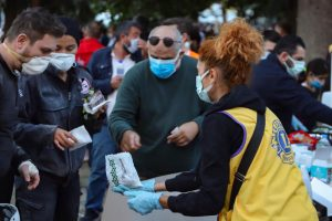 Lion hands out aid to earthquake vitims