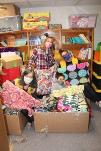 Lions Club members pose with fleece blankets
