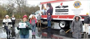 Lions club members pose with refrigerated truck