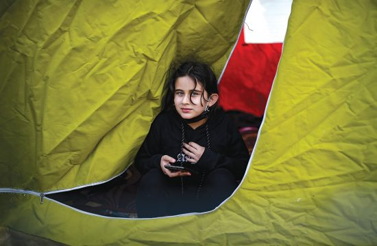 Girl peeks out of tent in Turkey