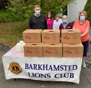 Barkhamsted Lions stand behind boxes of food
