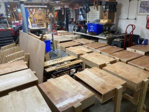 Workshop full of small desks build by Lions Club members