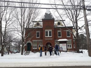 Knowlton Lions in front of historic building