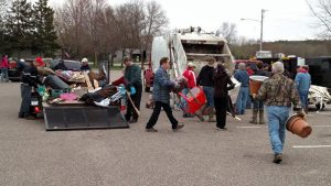 People load garbage into a truck