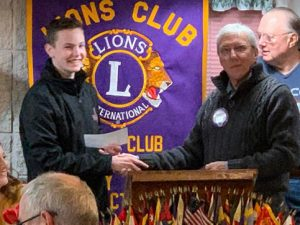 Preston Sharp accepting check from with Lions