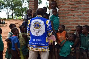man with colorful Lions Clubs jacket