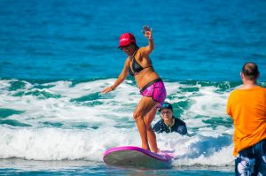 visually impaired woman surfs with help from Lions