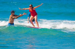 Blind woman catching a wave
