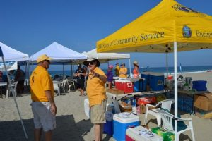 Lions working beachside stand during surfing clinic