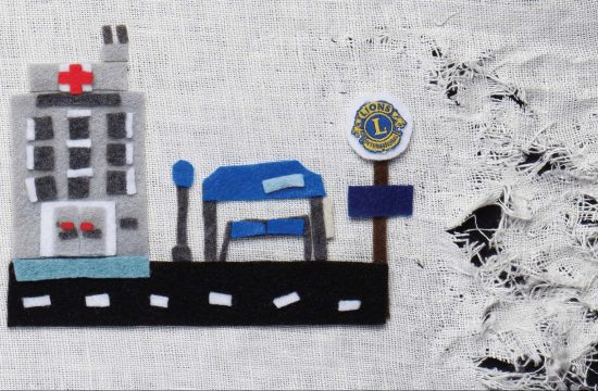 Hospital and bus stop made of felt and on unraveling fabric